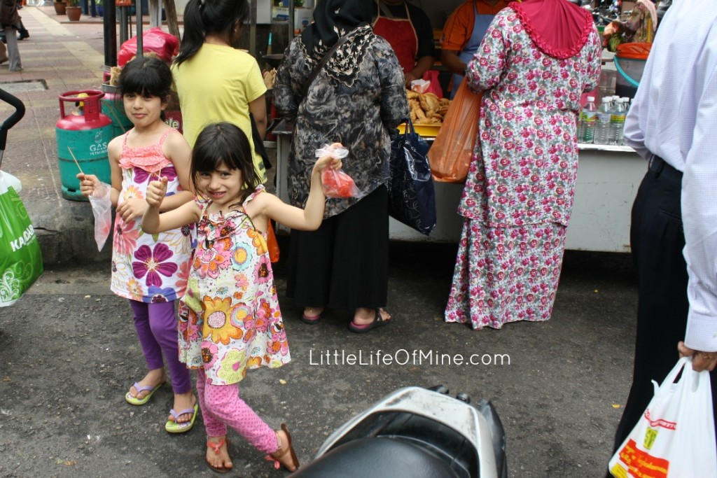 A snack of cool, fresh fruit on the hot streets of KL.